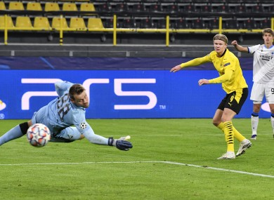 Haaland looks on at his goal-bound shot against Club Brugge.