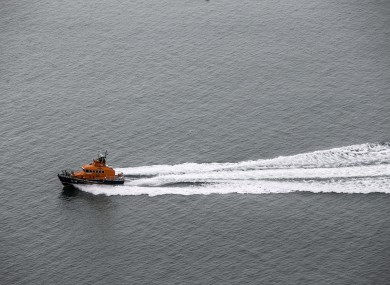 An RNLI Lifeboat around Howth Cliffs in Dublin