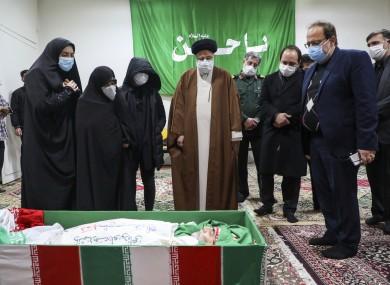 Ian's Judiciary Chief Ayatollah Ebrahim Raisi pays his respect to the body of slain scientist Mohsen Fakhrizadeh