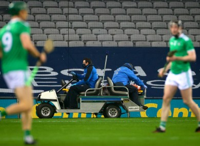 Joe Canning leaves the field due to injury.