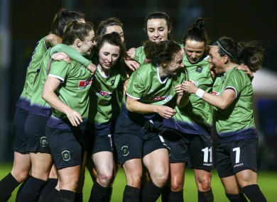 Peamount players celebrate a goal.