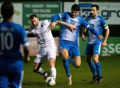 Finn Harps' Kosovar Sadiki and Waterford's Daryl Murphy battle for possession on Monday night.