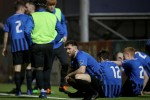 Lee Duffy dejected with his Athlone team-mates after the game.