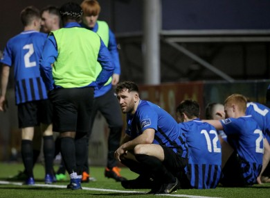 A dejected Lee Duffy with his Athlone team-mates after the game.