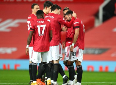 Manchester United's Bruno Fernandes (right) celebrates scoring.