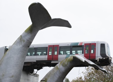The whale's tail of a sculpture caught the front carriage of a metro train as it rammed through the end of an elevated section of rails with the driver escaping injuries in Spijkenisse.
