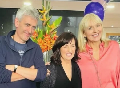 McCullagh (L) and O'Callaghan (R) pictured with the departing employee.