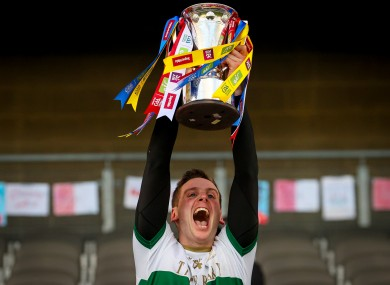 Captain Conor Sweeney lifts the cup after Tipperary's victory.