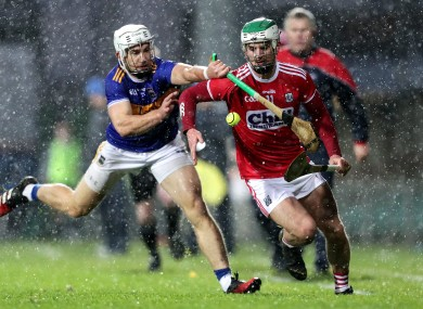 Tipperary's Niall O'Meara and Cork's Shane Kingston.