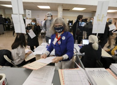 Worker at a polling station in New York.
