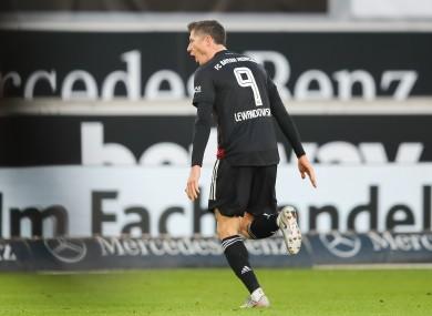 Robert Lewandowski celebrates his goal today.