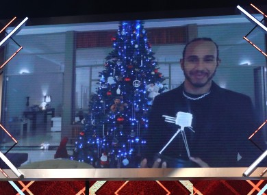 Lewis Hamilton reacts after winning the BBC Sports Personality of the Year award.