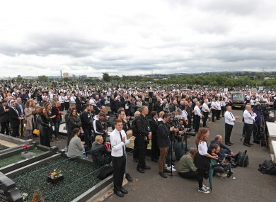 Crowds attend the funeral of Bobby Storey in June