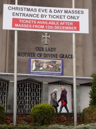 A sign relating to tickets for Christmas Eve and Christmas Day masses outside Our Lady Mother of Divine Grace church in Raheny, Dublin.