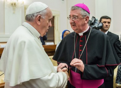 File image of Pope Francis with Archbishop of Dublin Diarmuid Martin who is retiring today.