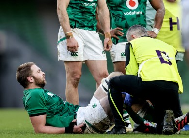 Henderson receives attention after sustaining injury on Ireland duty.