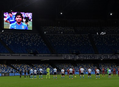 A portrait of Diego Maradona is seen on the screen during a minute of silence prior to the Serie A match between SSC Napoli and AS Roma at San Paolo stadium in Naples.