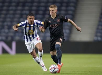 Manchester City's Oleksandr Zinchenko runs with the ball away from Porto's Jesus Corona.