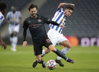 Manchester City's Bernardo Silva tangling with Otavio of Porto during Tuesday's fixture in the Champions League.