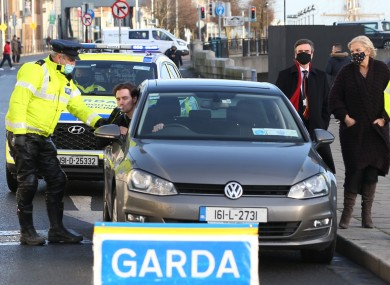 Garda Paul Burke and model Barry Donohue pose with a breathalyser at the media briefing for the Christmas and New Year Enforcement Operation.