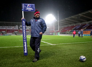 A groundsman removes a flag after the game is called off.