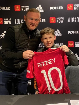 Chip off the old block: Wayne Rooney with his son Kai.