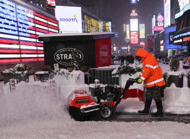 A worker cleans snow on Times Square in New York