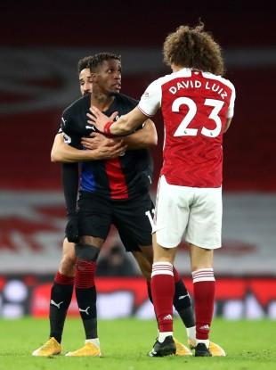 Crystal Palace's Wilfried Zaha (left) and Arsenal's David Luiz.