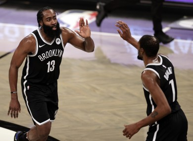 Brooklyn Nets guard James Harden celebrates with forward Kevin Durant during the second half against the Milwaukee Bucks,