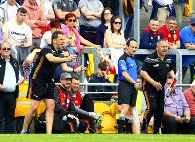 Steven Poacher (left) on the Carlow sideline in 2017.