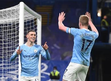 Phil Foden celebrates after scoring at Stamford Bridge.