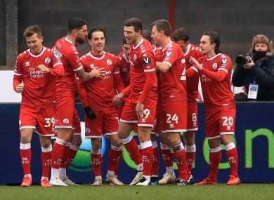 Crawley celebrate as Jordan Tunnicliffe scores their third goal.
