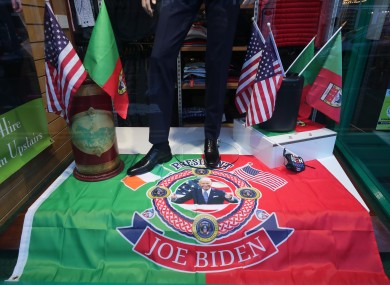 A window display with a flag showing President-elect Joe Biden in a men's clothing shop in Ballina, Co Mayo.