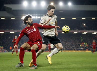 Liverpool forward Mo Salah and Man United captain Harry Maguire when the clubs met 12 months ago.