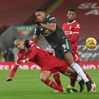 Liverpool's Fabinho (left) and Manchester United's Anthony Martial battle for the ball.