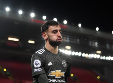 Manchester United's Bruno Fernandes reacts to a missed chance at Anfield.
