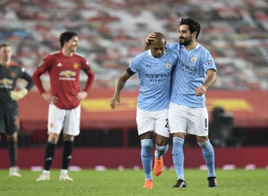 Fernandinho is congratulated by Ilkay Gundogan after scoring for Manchester City at Old Trafford.