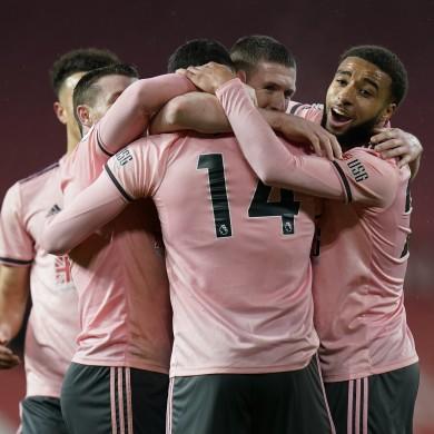 Sheffield United celebrate Oliver Burke's winning goal.