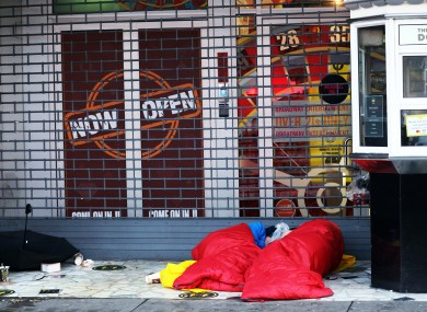 People in sleeping bags in the doorway by the famous Rolling Donut kiosk on Dublin's O'Connell Street.