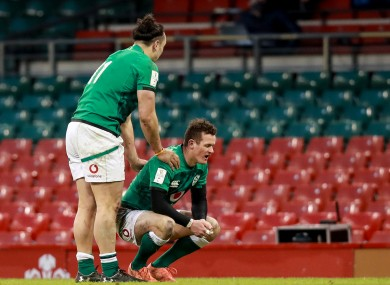 James Lowe with Billy Burns after the out-half missed touch.