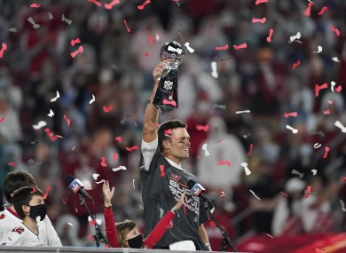 Brady: threw three touchdowns to lead the Bucs to victory.