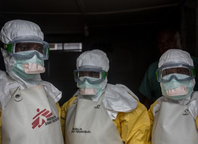 Medical staff dressed in protective gear dealing with 2019's ebola outbreak