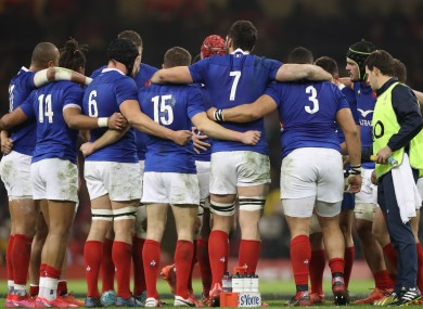 The France team in a huddle prior to last year's Six Nations fixture against Wales.
