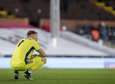 Sheffield United goalkeeper Aaron Ramsdale crouches dejected.