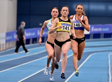 Phil Healy of Bandon AC, Cork, centre, on her way to winning the Women's 400m, with a PB of 51.99.