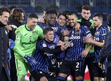 Atalanta players celebrate after their win over Napoli.