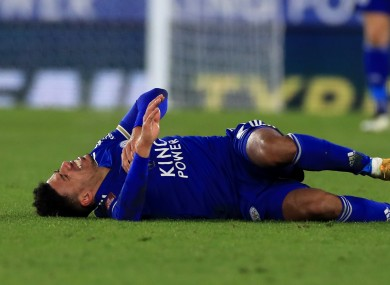 Leicester City's James Justin lies injured.