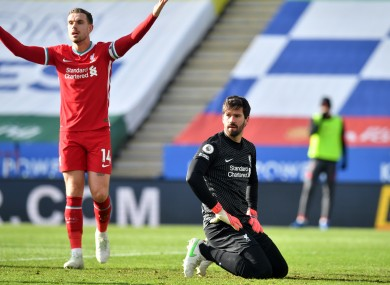 A dejected Alisson as Jordan Henderson appeals in vain after the concession of a goal.