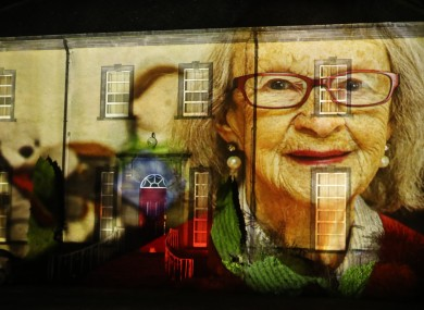 A portrait of survivor Peggy O'Kelly is projected onto Sean Ross Abbey as part of the Herstory Light Show to celebrate St Brigid's Day in February (file photo).