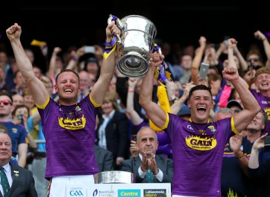 Wexford joint captains Matthew O'Hanlon and Lee Chin lift the Bob O'Keeffe Cup in 2019.